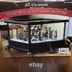 Mr Christmas Animated Illuminated Music Box with Rotating Skaters