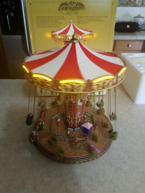Mr Christmas Gold Label World's Fair Swing Carousel- Plays 30 Songs