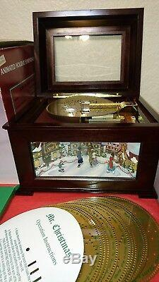 Mr Christmas animated skaters Holiday Symphonium with discs in box 16 discs IOB