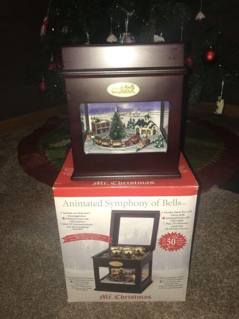 Mr Christmas Music Box Animated Symphony Of Bells Withmoving Train Plays 50 Songs